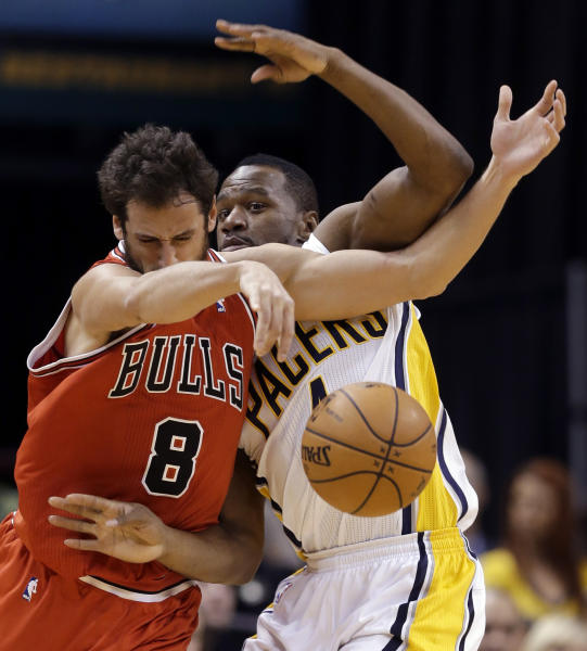 Chicago Bulls guard Marco Belinelli, left, and Indiana Pacers forward Sam Young get tied up in the second half of an NBA basketball game in Indianapolis, Monday, Feb. 4, 2013. The Pacers defeated the Bulls 111-101. (AP Photo/Michael Conroy)