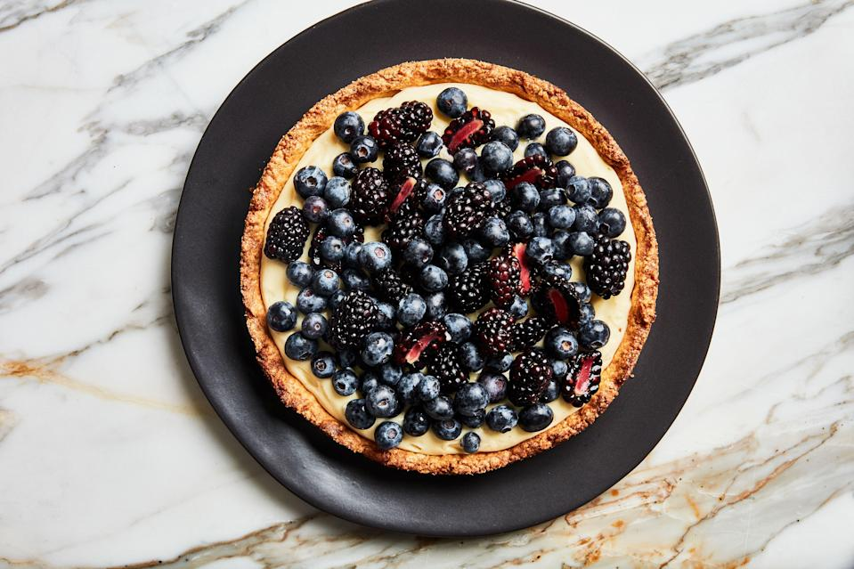 """Love a fruit tart but don't love rolling out dough in a hot kitchen? Good thing this stunner has a no-fuss press-in crust. <a href=""""https://www.epicurious.com/recipes/food/views/fresh-fruit-berry-tart-with-almond-press-in-crust?mbid=synd_yahoo_rss"""" rel=""""nofollow noopener"""" target=""""_blank"""" data-ylk=""""slk:See recipe."""" class=""""link rapid-noclick-resp"""">See recipe.</a>"""
