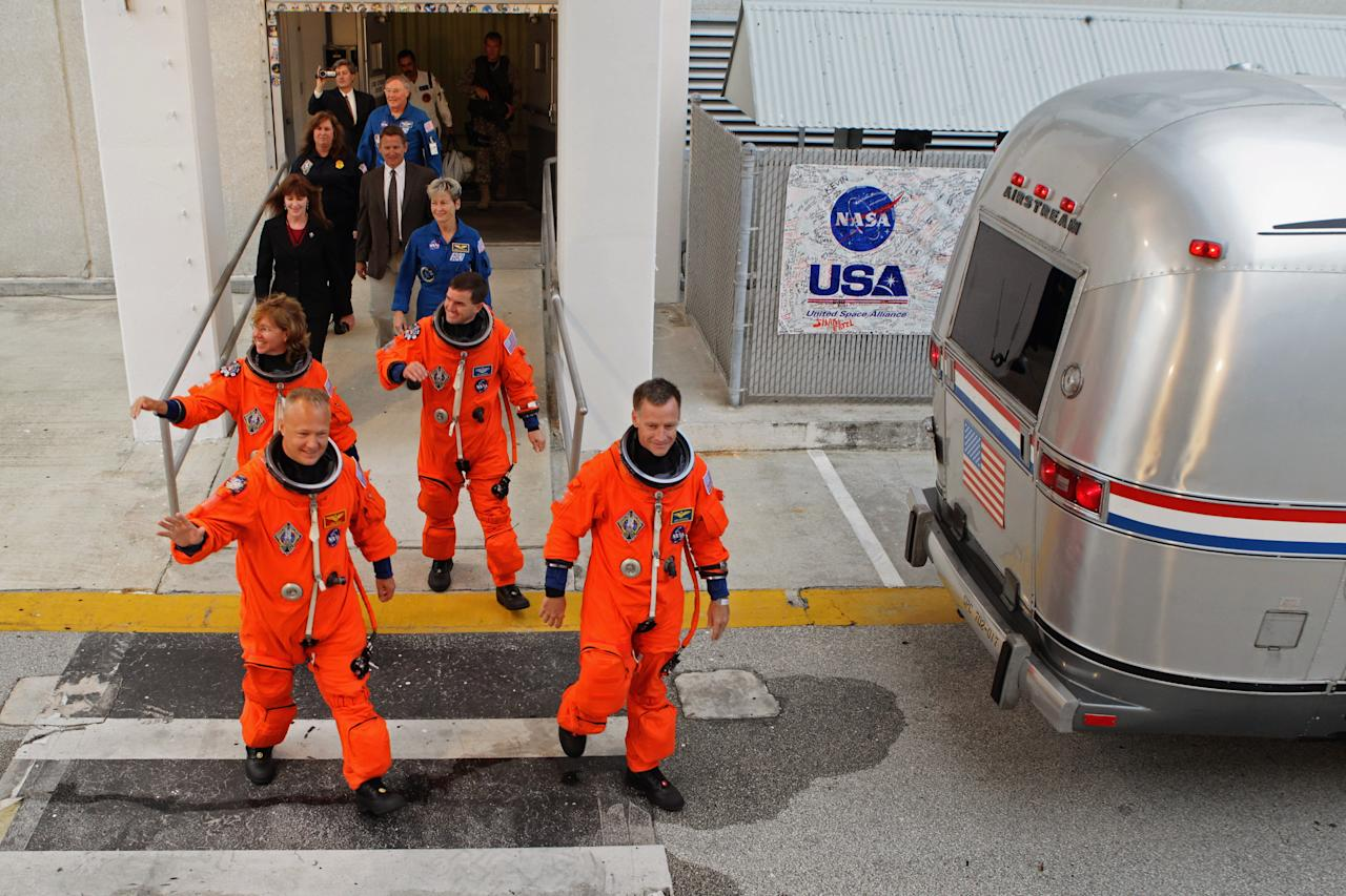 CAPE CANAVERAL, FL - JULY 08:  (L-R) Space shuttle Atlantis STS-135 mission specialist Sandra Magnus, pilot Douglas Hurley, mission specialist Rex Walheim and Commander Christopher Ferguson walk out of the NASA Operations and Checkout building hours before their scheduled launch at Kennedy Space Center July 7, 2011 in Cape Canaveral, Florida. Bad weather conditions threaten Atlantis' launch, which will mark the final liftoff in the 30-year-old space shuttle program.  (Photo by Chip Somodevilla/Getty Images)