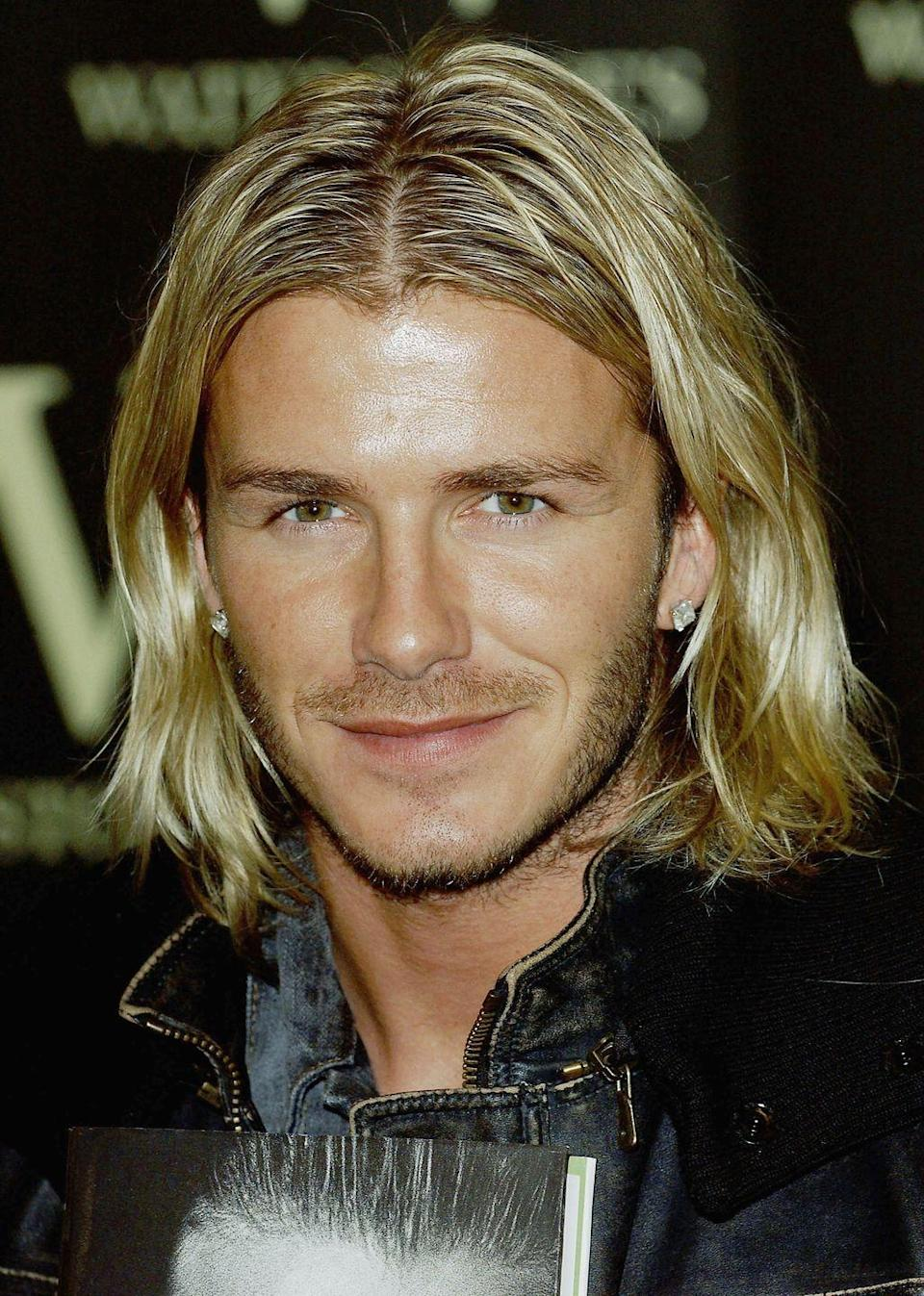 <p>Throughout the years, David Beckham has become almost as famous for his varying hairstyles as for his soccer skills. In 2003, the British football star grew his blonde hair to his shoulders.</p>