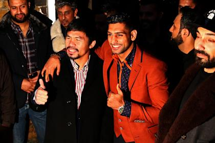 Manny Pacquiao and Amir Khan pose on Friday after holding discussions about the possibility of a future fight. (Photo by Dan Istitene/Getty Images)