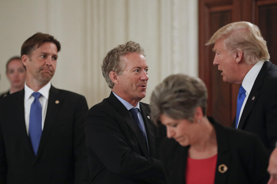 President Donald Trump stops to greet Sen. Rand Paul, R-Ky., center, and Sen. Ben Sasse, R-Neb. during a luncheon with GOP leadership, Wednesday, July 19, 2017. (AP Photo/Pablo Martinez Monsivais)