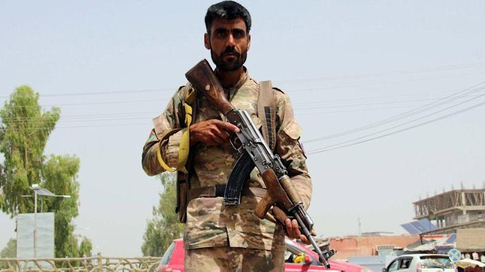 An Afghan security official stands guard at a check point in Lashkar Gah, the provincial capital of Helmand province, Afghanistan, 11 July 2021.