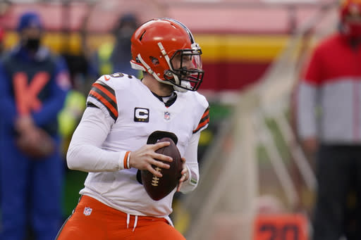 Cleveland Browns quarterback Baker Mayfield throws a pass during the first half of an NFL divisional round football game against the Kansas City Chiefs, Sunday, Jan. 17, 2021, in Kansas City. (AP Photo/Jeff Roberson)