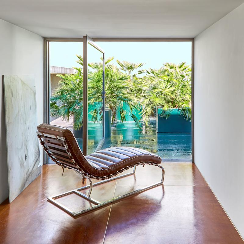 From a nook in the master bath, a vintage leather chaise longue overlooks the terrace.