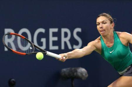 Aug 8, 2018; Montreal, Quebec, Canada; Simona Halep of Romania hits a shot against Anastasia Pavlyuchenkova of Russia (not pictured) during the Rogers Cup tennis tournament at IGA Stadium. Mandatory Credit: Jean-Yves Ahern-USA TODAY Sports