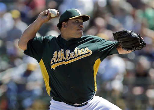 Oakland Athletics starting pitcher Bartolo Colon throws to the Milwaukee Brewers during the first inning of an exhibition spring training baseball game on Monday, March 25, 2013 in Phoenix. (AP Photo/Marcio Jose Sanchez)