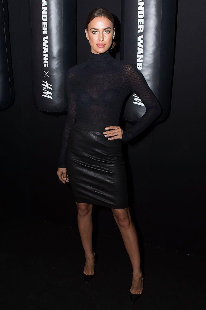 <p>The model wore a black sheer top with a leather-look pencil skirt. </p>