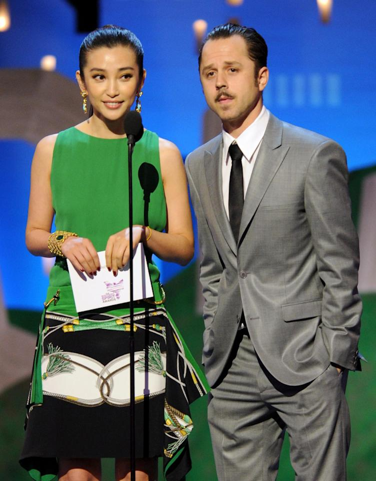 Bingbing Li, left, and Giovanni Ribisi present an award onstage at the Independent Spirit Awards on Saturday, Feb. 25, 2012, in Santa Monica, Calif. (AP Photo/Vince Bucci)