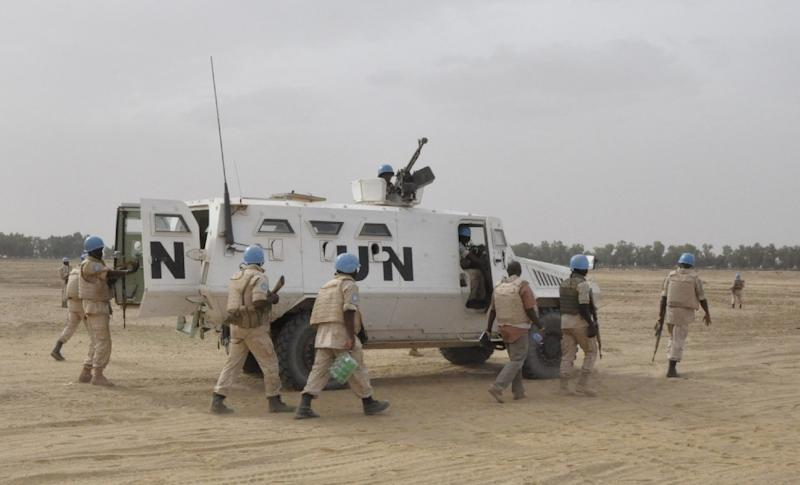 UN peacekeepers patrol on May 12, 2015 in Timbuktu, where ninet Malian soldiers were killed by the rebel Coordination of Azawad Movements (CMA) between Timbuktu and Goundam on May 11. AFP PHOTO / ALOU SISSOKO (AFP Photo/Alou Sissoko)