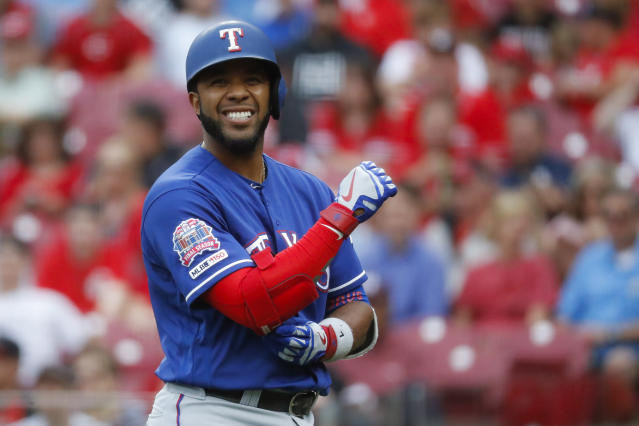 Texas Rangers' Elvis Andrus reacts after being hit by a pitch in the first inning of a baseball game against the Cincinnati Reds, Friday, June 14, 2019, in Cincinnati. (AP Photo/John Minchillo)