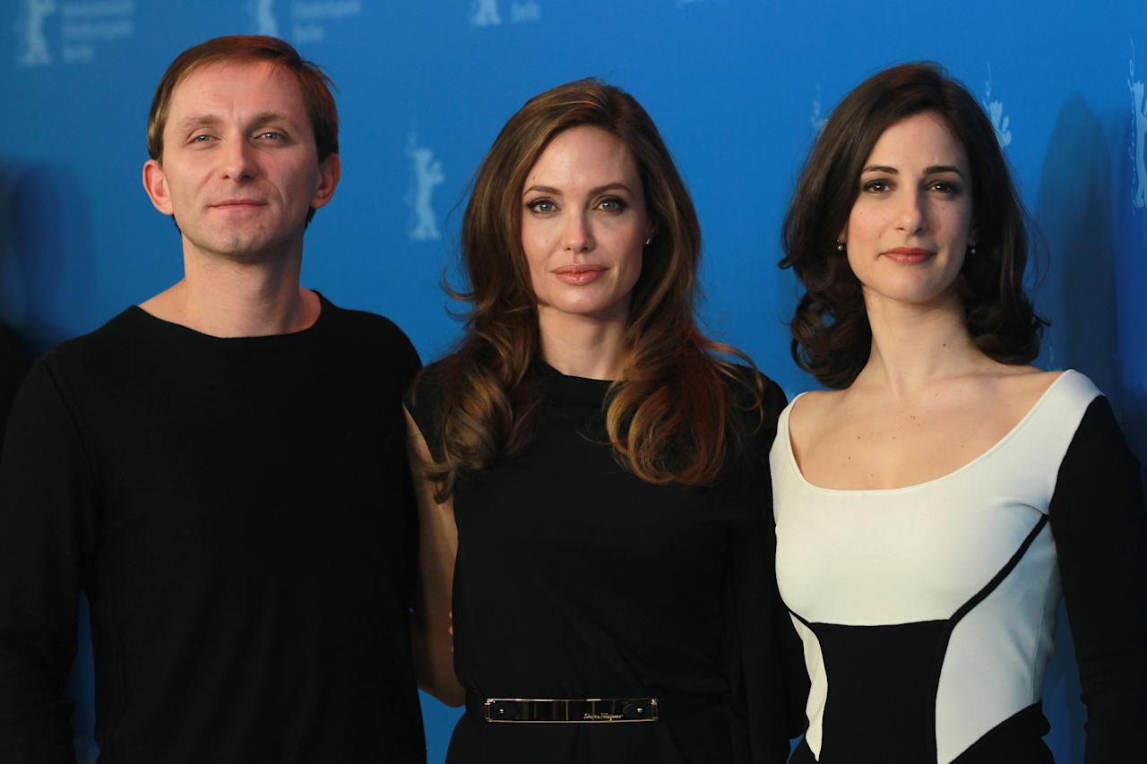 """BERLIN, GERMANY - FEBRUARY 11:  (L-R)  Actor Goran Kostic, director Angelina Jolie and actress Zana Marjanovic attend the """"In The Land Of Blood And Honey"""" Photocall during day three of the 62nd Berlin International Film Festival at the Grand Hyatt on February 11, 2012 in Berlin, Germany.  (Photo by Sean Gallup/Getty Images)"""