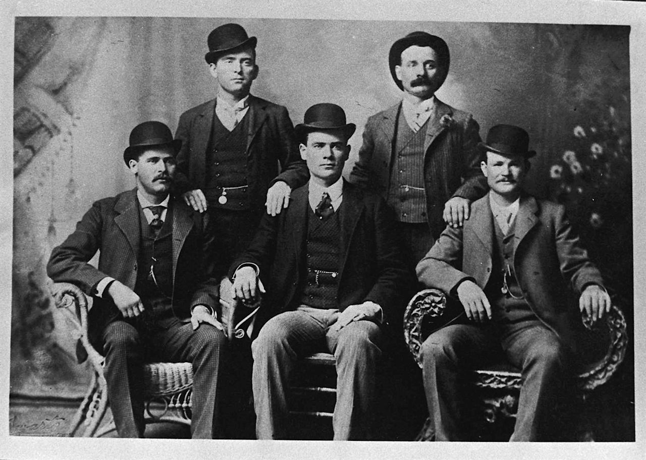 FILE - This image provided by the Nevada Historical Society shows the famous group portrait taken in Fort Worth, Texas shortly after Butch Cassidy and his gang robbed the Einnemucca, Nev., bank in 1900. They sent the photo to the bank with a thank you note. Shown are Bill Carver, top left, the Sundance Kid, bottom left, and Butch Cassidy, bottom right. The other two members of the gang are not identified. A collector of rare books and documents has obtained a manuscript with new evidence that Butch Cassidy wasn't killed in a 1908 shootout in Bolivia but returned to the U.S. and lived on in Washington State for almost three decades. (AP Photo/Nevada Historical Society, File)
