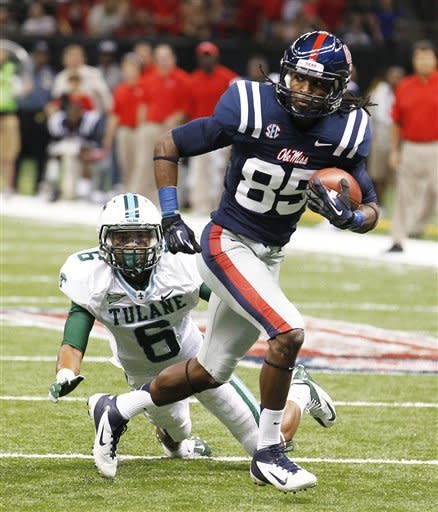 Mississippi wide receiver Ja-Mes Logan (85) runs past Tulane cornerback Lorenzo Doss (6) on his way to scoring a touchdown in the first half of an NCAA college football game in New Orleans, Saturday, Sept. 22, 2012. (AP Photo/Bill Haber)
