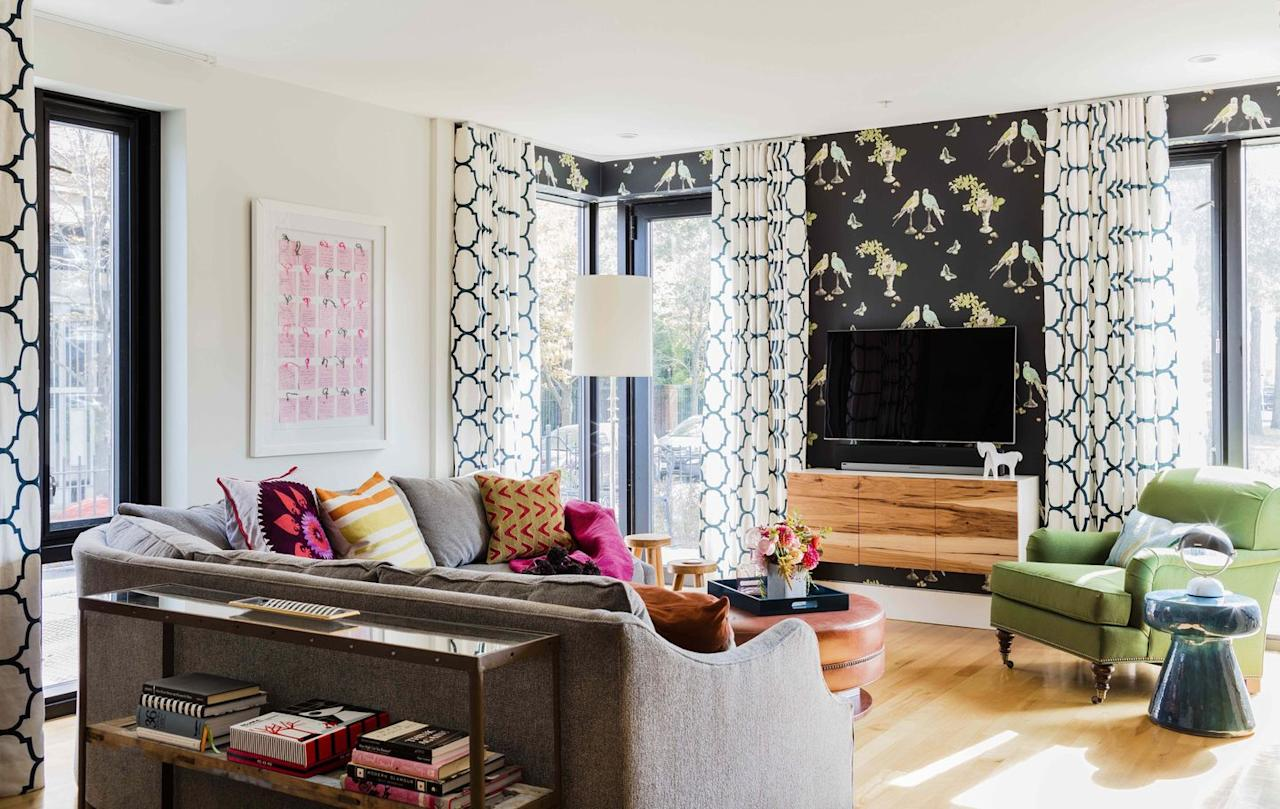 "<p>Mismatched patterns create an eclectic vibe in this bright living space by <a href=""https://deringhall.com/interior-designers/kmid-kate-maloney-interior-design"">KMID 