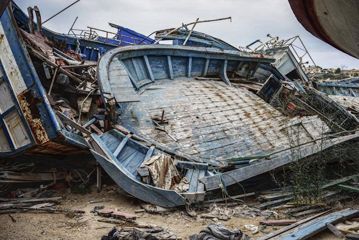 LAMPEDUSA, ITALY - SEPTEMBER 8: A migrant ship graveyard on September 8, 2014 in Lampedusa, Italy. In the early days of mass migration from North Africa, Italian authorities would tow the ships full of migrants into the port, where they dumped into this boatyard. Nowadays, Italian authorities are ordered to destroy the migrant boats at sea after having transferred the migrants onto coast guard boats. Many of the boats are bought by human trafficking gangs for the sole purpose of transporting migrants over the Mediterranean Sea. They're often steered by inexperienced and poorly trained crew members.(Photo by Giles Clarke/Getty Images)