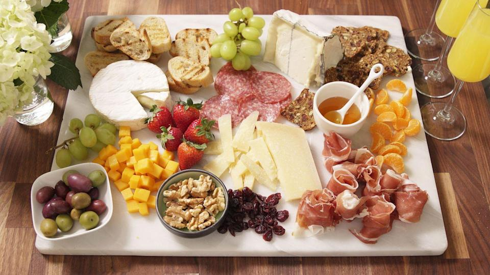 """<p>Prettier than what you have pinned on Pinterest.</p><p>Get the recipe from <a href=""""https://www.delish.com/cooking/videos/a47139/how-to-make-the-ultimate-cheeseboard/"""" rel=""""nofollow noopener"""" target=""""_blank"""" data-ylk=""""slk:Delish"""" class=""""link rapid-noclick-resp"""">Delish</a>.</p>"""
