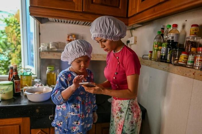 The youngster's cooking operations are guided by the experienced hands of her social influencer mum, Honey Cho (AFP Photo/Ye Aung THU)