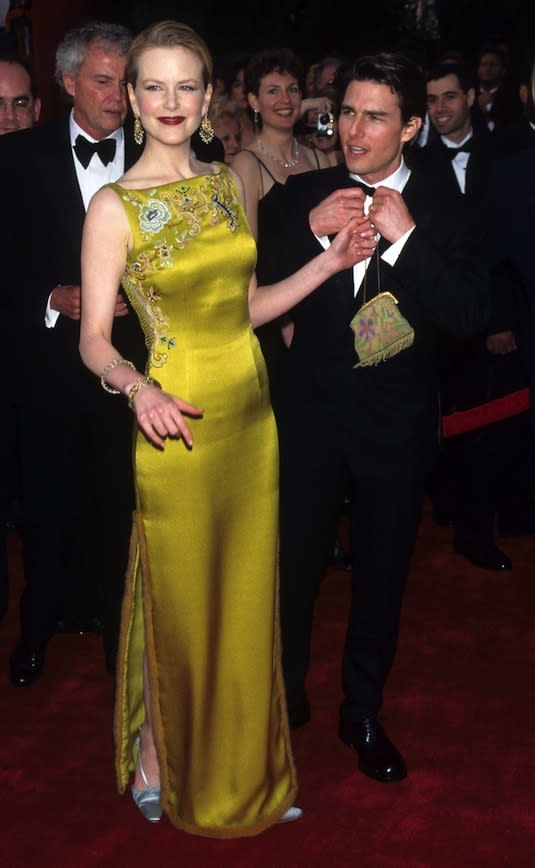 Making an entrance at the 1997 Academy Awards in a stunning Chinese-inspired gown
