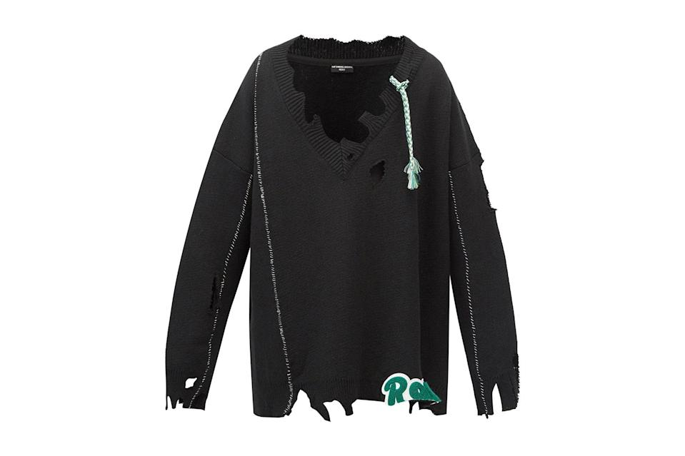 """$1897, Matches. <a href=""""https://www.matchesfashion.com/us/products/Raf-Simons-AW16-distressed-monogram-appliqu%C3%A9-wool-sweater-1396602"""" rel=""""nofollow noopener"""" target=""""_blank"""" data-ylk=""""slk:Get it now!"""" class=""""link rapid-noclick-resp"""">Get it now!</a>"""