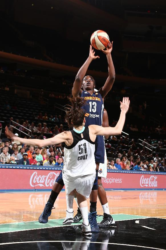 NEW YORK, NY - JUNE 29: Chiney Ogwumike #13 of the Connecticut Sun shoots over Anna Cruz #51 of the New York Liberty during a game at Madison Square Garden in New York City on June 29, 2014. (Photo by Nathaniel S. Butler/NBAE via Getty Images)