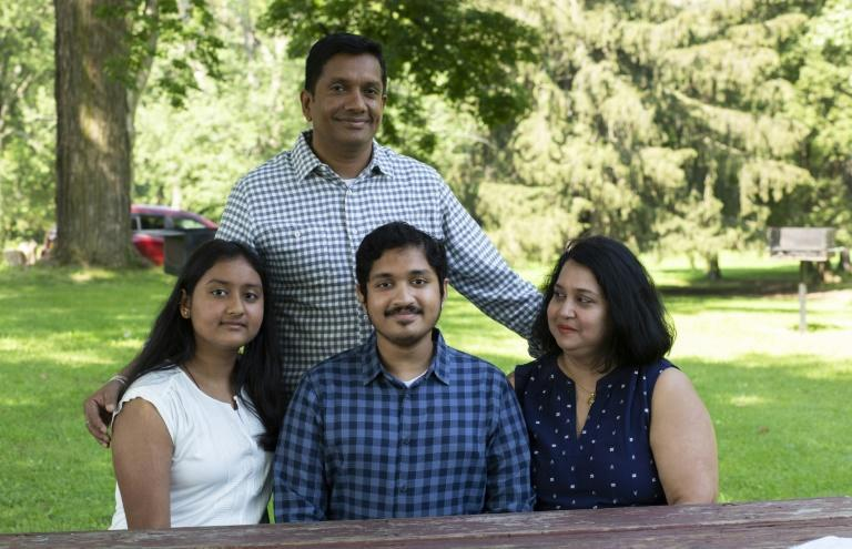 Anish Shrivastava (center) is pictured with his mother Jaya Ghosh, his sister Aanika and his father Ashish in Troy, New York