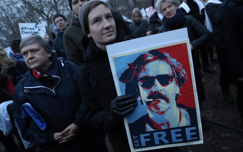 Protesters gather outside the Turkish Embassy to demand the release of German journalist Deniz Yucel in Berlin - Credit: Getty Images