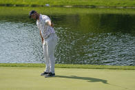 Jon Rahm reacts to a birdie putt on the 16th green during the third round of the Memorial golf tournament, Saturday, June 5, 2021, in Dublin, Ohio. (AP Photo/Darron Cummings)