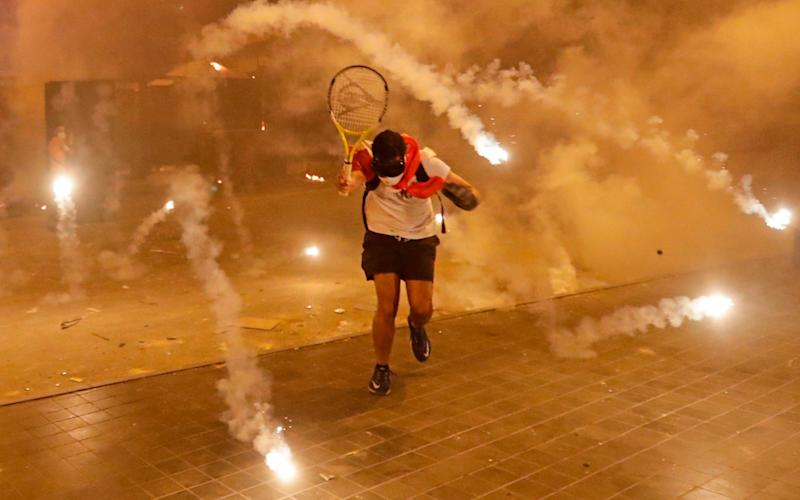 Protesters calling for the resignation of Lebanon's government clashed with security forces in Beirut for two nights over the weekend - AFP