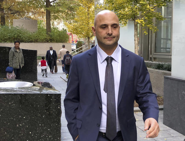 Former sports radio host Craig Carton leaves Manhattan federal court Wednesday in New York after being convicted of fraud. (AP Photo/Lawrence Neumeister)