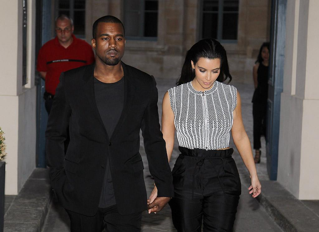 "Kanye West checks Kim Kardashian's text messages ""every night"" because her phone often goes off late, and he's ""not totally convinced"" she's being faithful, given her ""sexual history,"" reports <em>OK!</em> The mag says Kardashian told him he could ""check her phone anytime he wanted."" For why West is now even less trusting, see what a Kardashian confidante reveals to<a target=""_blank"" href=""http://www.gossipcop.com/kim-kardashian-cheating-kanye-west-text-messages-cell-phone-reggie-bush/""> Gossip Cop</a>."