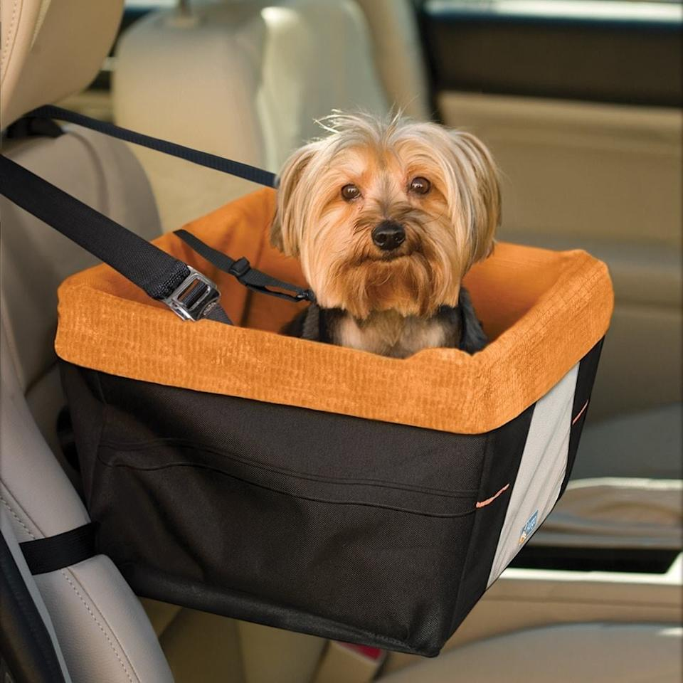 """<p>Give your dog a window seat with this <a href=""""https://www.popsugar.com/buy/Skybox%20Dog%20Booster%20Seat-447678?p_name=Skybox%20Dog%20Booster%20Seat&retailer=kurgo.com&price=64&evar1=moms%3Aus&evar9=46159454&evar98=https%3A%2F%2Fwww.popsugar.com%2Ffamily%2Fphoto-gallery%2F46159454%2Fimage%2F46159479%2FSkybox-Dog-Booster-Seat&list1=shopping%2Ctravel%2Cdogs%2Ccats%2Cpets%2Ctravel%20goods&prop13=api&pdata=1"""" rel=""""nofollow"""" data-shoppable-link=""""1"""" target=""""_blank"""">Skybox Dog Booster Seat</a> ($64).</p>"""