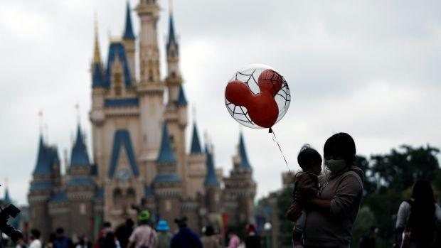Visitors are seen, amid the coronavirus disease (COVID-19) outbreak, at Tokyo Disneyland in Urayasu