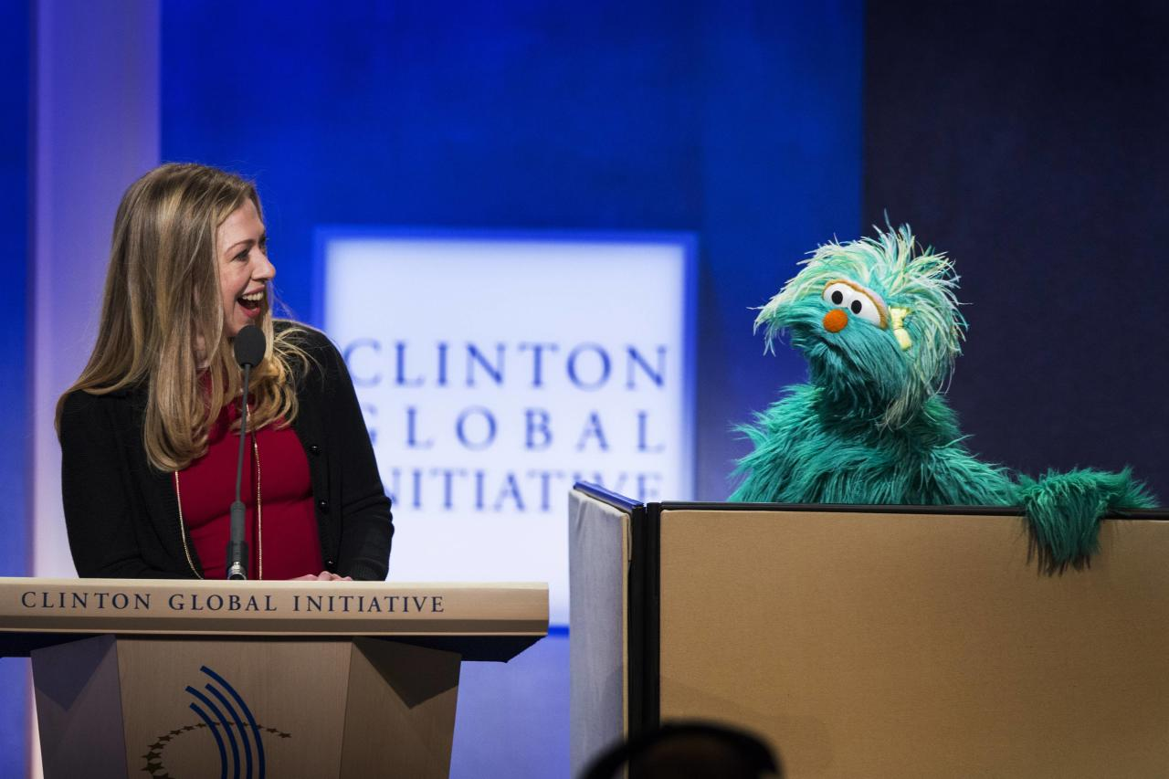 Chelsea Clinton, daughter of former U.S. President Bill Clinton, speaks to Rosita the muppet during the Clinton Global Initiative (CGI) in New York September 24, 2013. The CGI was created by Bill Clinton in 2005 to gather global leaders to discuss solutions to the world's problems. REUTERS/Lucas Jackson (UNITED STATES - Tags: POLITICS HEALTH ENTERTAINMENT)