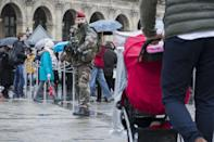 """A French soldier patrols in the courtyard of the Louvre museum in Paris, Saturday, Feb. 4, 2017. The Louvre in Paris reopened to the public Saturday morning, less than 24-hours after a machete-wielding assailant shouting """"Allahu Akbar!"""" was shot by soldiers, in what officials described as a suspected terror attack.(AP Photo/Kamil Zihnioglu)"""
