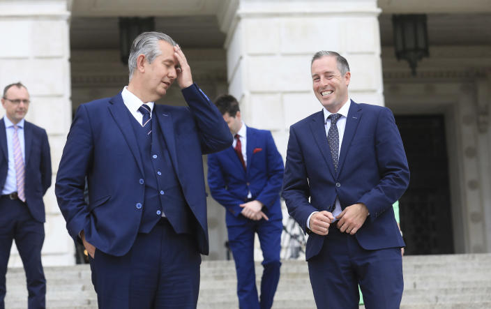 Democratic Unionist Party leader Edwin Poots, and party colleague Paul Givan, right, arrive to face the media at Stormont Buildings parliament in Belfast, Northern Ireland, Tuesday, June 8, 2021. Paul Givan was named as Northern Ireland's First Minister designate by the party leader Edwin Poots during a press conference Tuesday. (AP Photo/Peter Morrison)