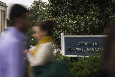 Workers arrive at the Office of Personnel Management in Washington