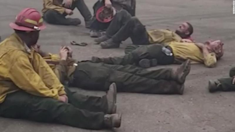 Exhausted firefighters sing together after a 14-hour shift battling wildfires in Oregon