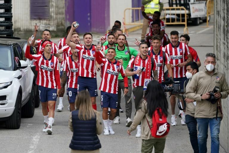 Atletico Madrid's players celebrate outside the stadium after winning the Spanish Liga Championship in Valladolid