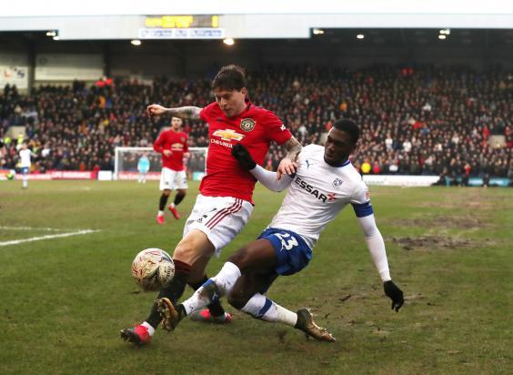 Manchester United's Victor Lindelof challenges for the ball (Reuters)