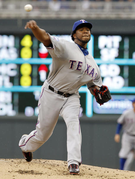 Texas Rangers starting pitcher Neftali Feliz throws against the Minnesota Twins during the first inning of a baseball game on Sunday, April 15, 2012, in Minneapolis. The players were all wearing No. 42 in honor of Jackie Robinson Day. (AP Photo/Genevieve Ross)