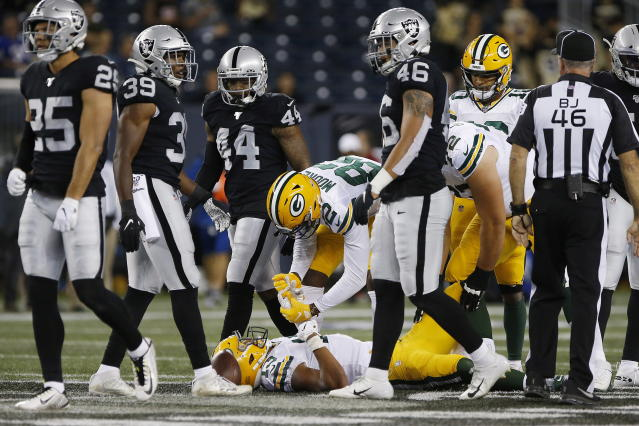 Green Bay Packers wide receiver J'Mon Moore (82) checks on Allen Lazard (13) during the second half of the team's NFL preseason football game against the Oakland Raiders on Thursday, Aug. 22, 2019, in Winnipeg, Manitoba. (John Woods/The Canadian Press via AP)