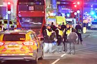 <p>Police officers with riot shields on Borough High Street as police are responding to three incidents in the capital, amid reports that a vehicle collided with pedestrians on London Bridge, Scotland Yard said. (Press Association) </p>