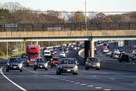 Vehicles travel westbound on Interstate 695, Tuesday, Nov. 24, 2020, in Parkville, Md. (AP Photo/Julio Cortez)