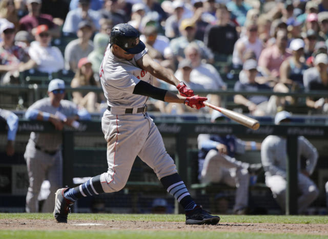 Boston Red Sox's Xander Bogaerts hits a two-run home run on a pitch from Seattle Mariners' Chasen Bradford during the seventh inning of a baseball game, Sunday, June 17, 2018, in Seattle. (AP Photo/John Froschauer)