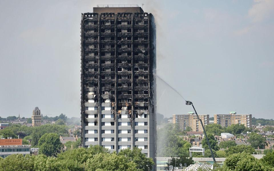 Firefighters spraying water after the fire engulfed Grenfell Tower in west London - Victoria Jones/PA