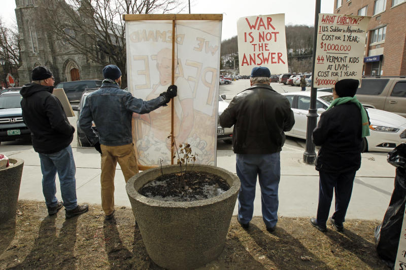 In this March 15, 2013 photo, protesters hold signs in front of the federal building in Montpelier, Vt. More than a decade after anti-war protesters started a weekly vigil in front of the Montpelier post office, they keep coming. Sometimes only a handful, but ever since the U.S. invaded Afghanistan they have come. They've outlasted the U.S. war in Iraq.  From right, John Snell , Glen Hutcheson, Dave Connor and Ann Burcroff. (AP Photo/Toby Talbot)