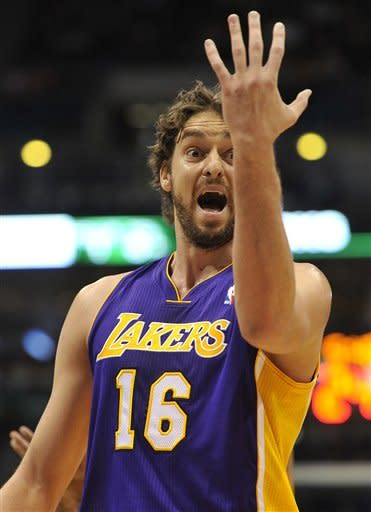 Los Angeles Lakers' Pau Gasol (16) reacts to a foul against the Milwaukee Bucks during the first half of an NBA basketball game on Saturday, Jan. 28, 2012, in Milwaukee. (AP Photo/Jim Prisching)
