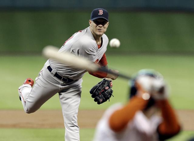 Boston Red Sox's Jake Peavy, left, delivers a pitch to Houston Astros' Jose Altuve in the first inning of a baseball game Saturday, July 12, 2014, in Houston. (AP Photo/Pat Sullivan)