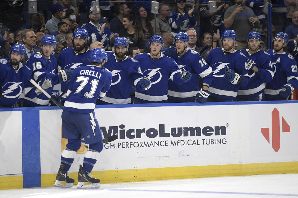 Tampa Bay Lightning center Anthony Cirelli (71) is congratulated by teammates after scoring during the second period of a preseason NHL hockey game against the Florida Panthers, Thursday, Oct. 7, 2021, in Tampa, Fla. (AP Photo/Phelan M. Ebenhack)